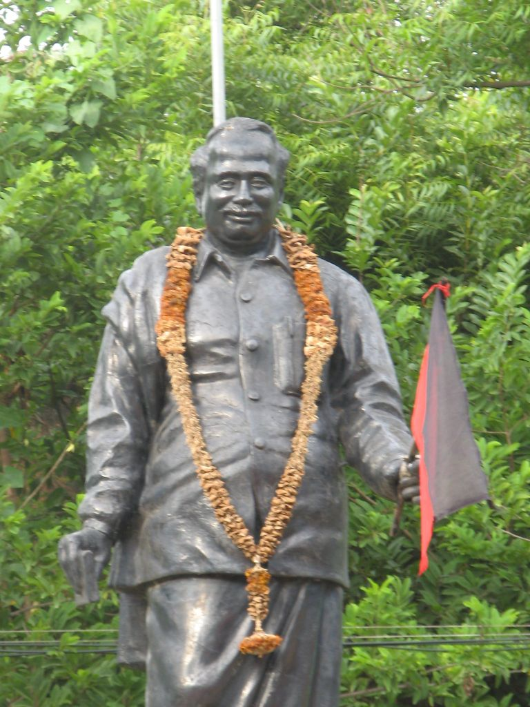 Statue of Anna waving the DMK flag